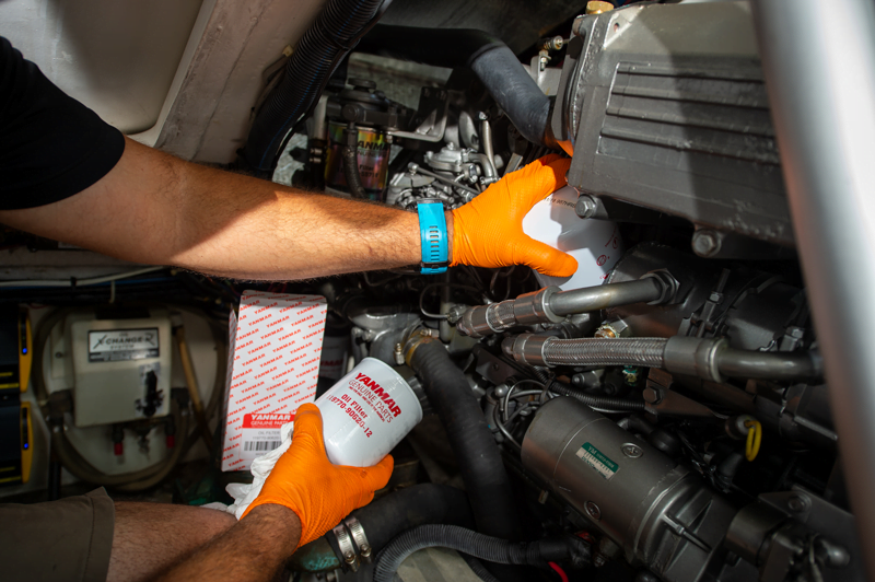 YMI Service tech changing oil filter