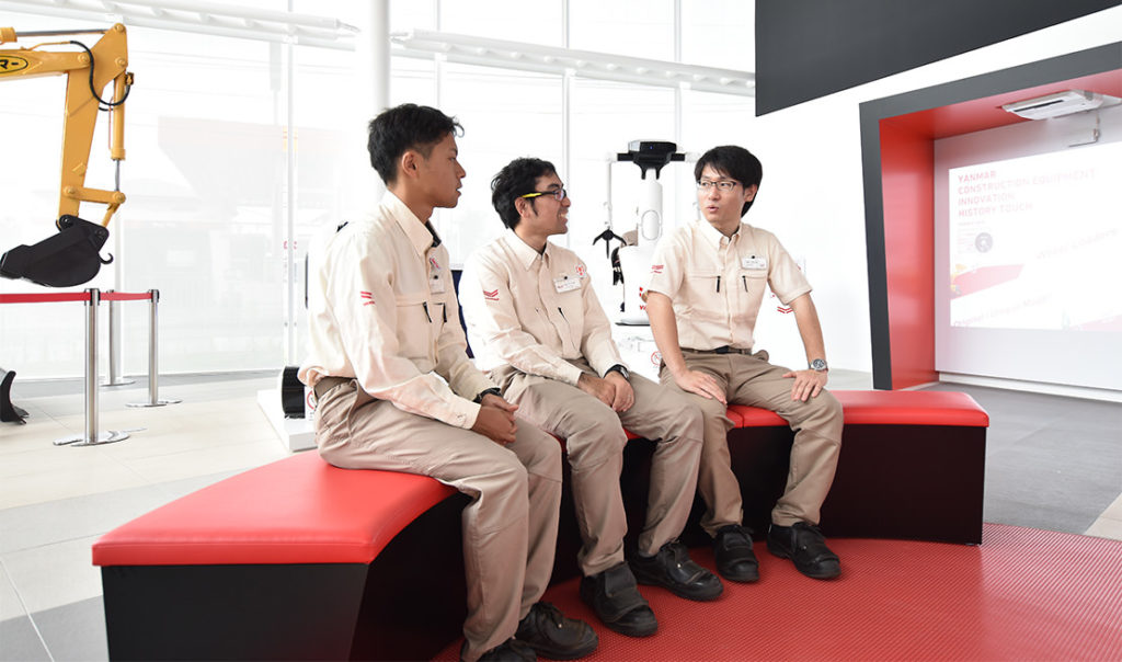 Being interviewed in front of one of the concept construction equipment on display in the show room. From left to right: Kazuki, Fumitaka and Kotaro