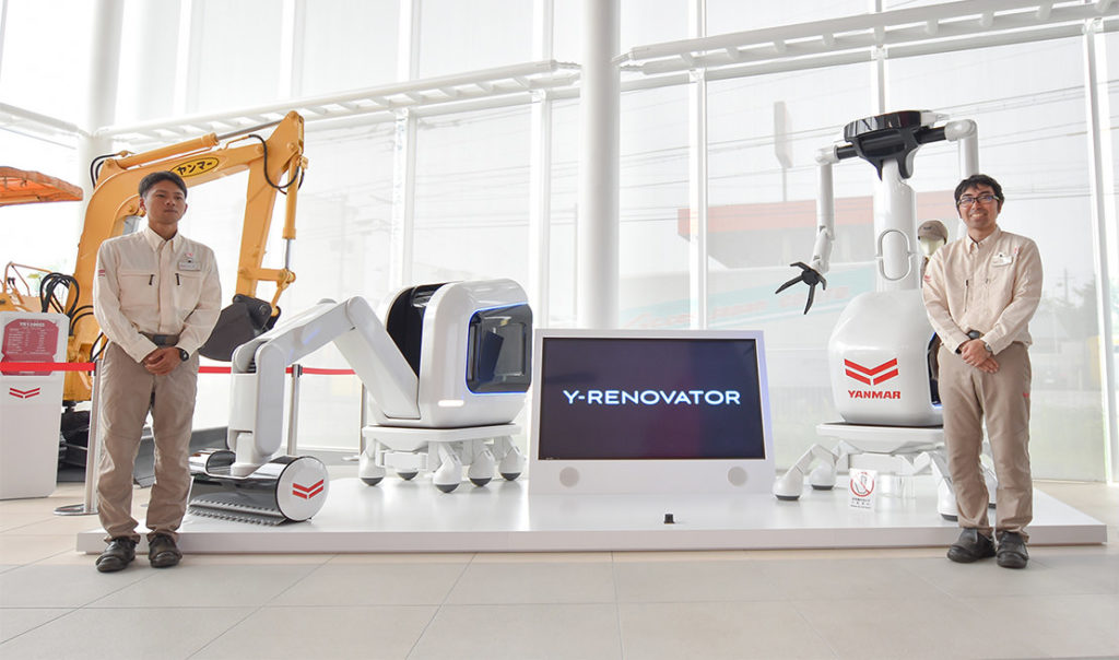 "In the foreground of the ""Y-RENOVATOR"" concept construction equipment on display in the show room"